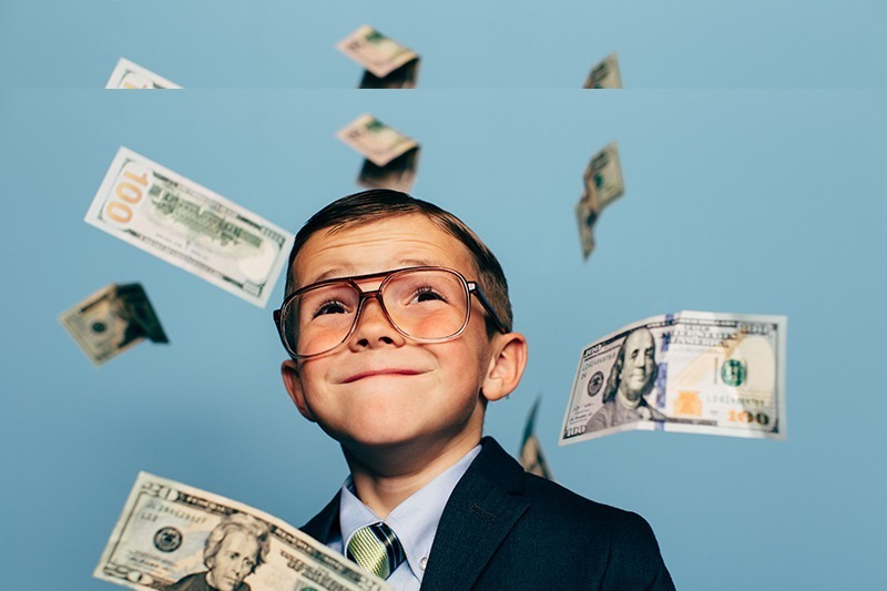 rsz_young-boy-accountant-falling-money_small